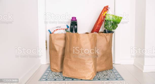 Grocery online delivery receiving grocery bags at home entrance door picture id1220053685?b=1&k=6&m=1220053685&s=612x612&h=l9ebwtakknmpeqjna 2tehsc kdk1nyi tb1yu1z4b0=