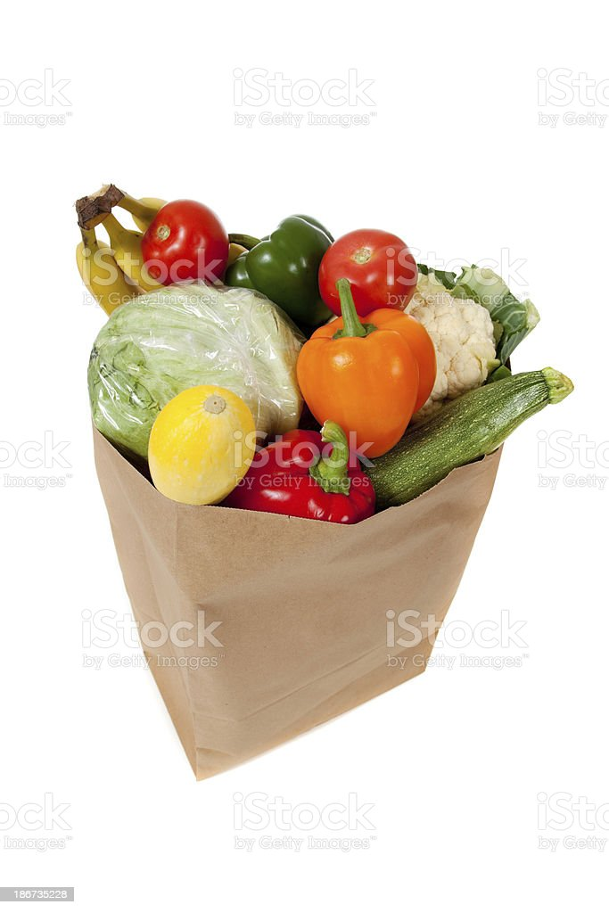 grocery sack full of vegetables on a white background royalty-free stock photo