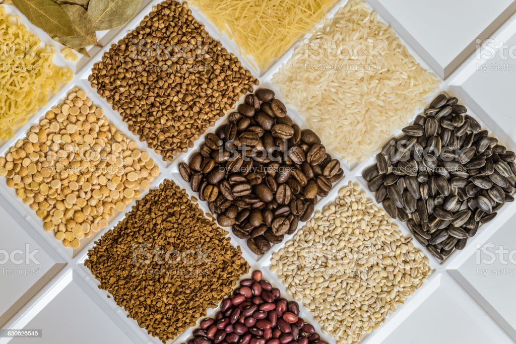 Grocery set of food products: vermicelli, rice, sunflower seeds, bay leafs, buckwheat, roasted coffee beans, pearl barley, figured macaroni, dried peas, freeze-dried instant coffee, dried seeds of beans. stock photo