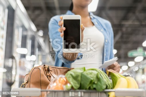 istock Grocery shopper shows blank screen on smart phone 932439986