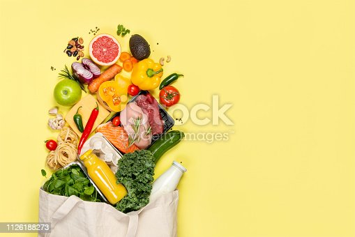 istock Grocery shopping concept - foods with shopping bag 1126188273