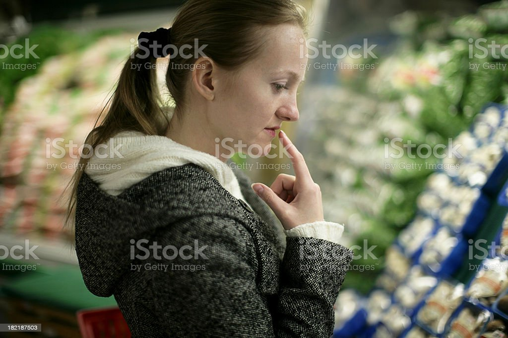 Grocery Shopping Decisions royalty-free stock photo