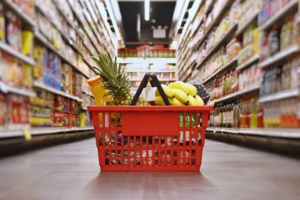 Grocery shopping Grocery basket with products shopping basket stock pictures, royalty-free photos & images