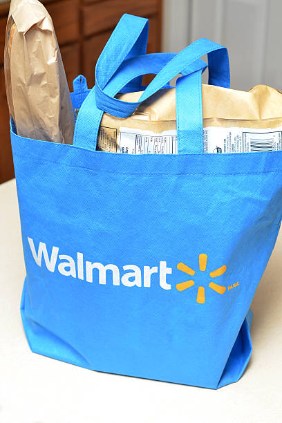 Grocery Shopping Vancouver, Canada -- February 4, 2012:Close up of a cloth bag full of groceries from Walmart in a residential kitchen.  Walmart is a worldwide discount retailer of groceries and merchandise. wal mart stock pictures, royalty-free photos & images