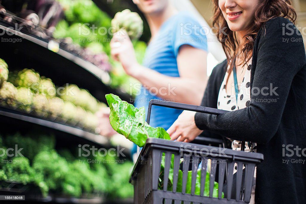 Grocery Shopping Young Couple at Store royalty-free stock photo