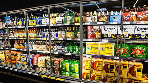 grocery store beer cooler - beer alcohol stock pictures, royalty-free photos & images