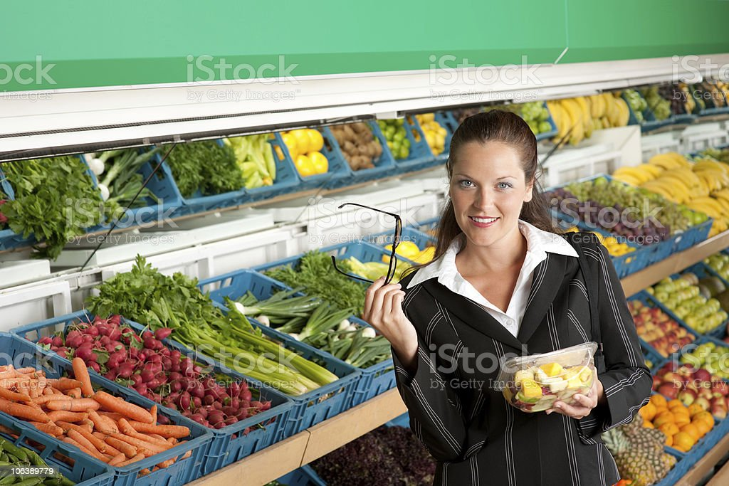 Grocery store - Businesswoman shopping in supermarket royalty-free stock photo