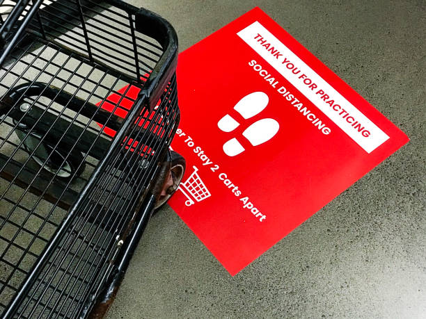 COVID-19 Grocery Store Checkout Line Social Distancing Sign Notice stock photo
