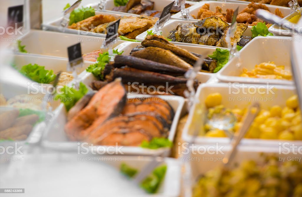 Grocery store. Different take out food on sale stock photo