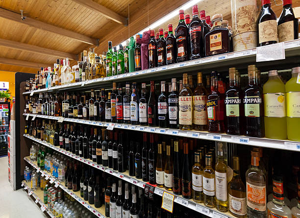 grocery store liquor department - alcohol stock photos and pictures