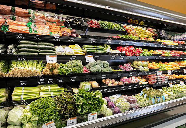 Grocery Store Produce Department Produce section in grocery store produce aisle stock pictures, royalty-free photos & images