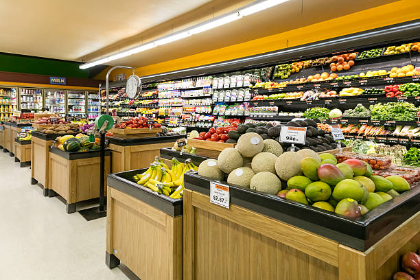 Grocery Store Produce Department Produce section in grocery store wide angle produce aisle stock pictures, royalty-free photos & images