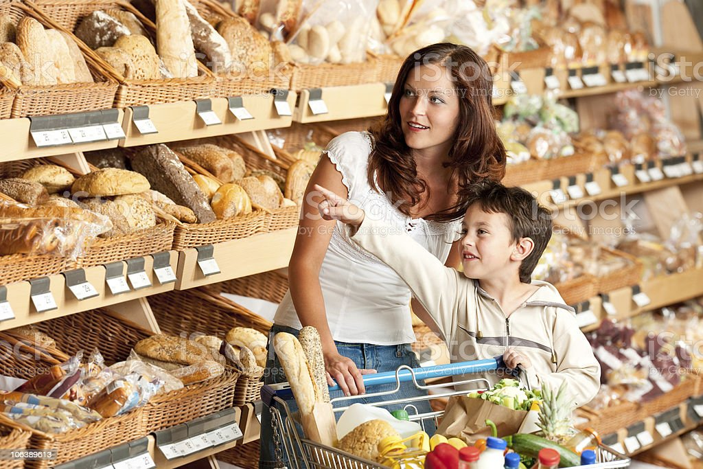 Grocery store - Woman with child in a supermarket stock photo