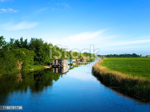Groningen, Netherlands: Sunny Early Morning Idyll: Canal, Houseboats, Calm. Shot near Garnwerd, just outside Groningen City.