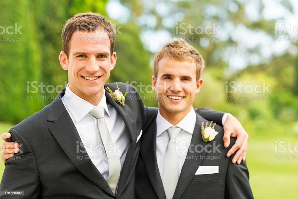 Groom And Best Man With Arms Around Each Other stock photo