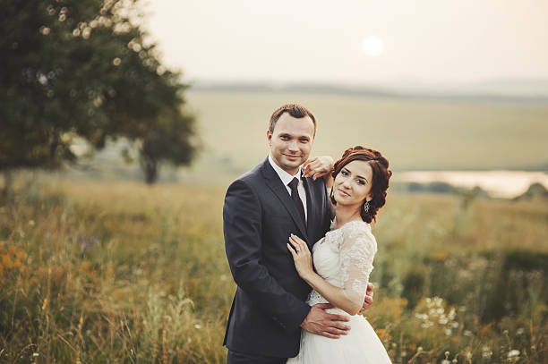 Groom and bride at countryside. Newlyweds together. stock photo