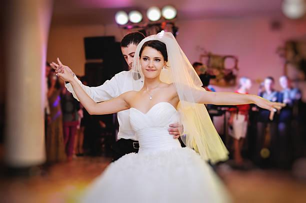 groom and bride dancing in restaurant stock photo