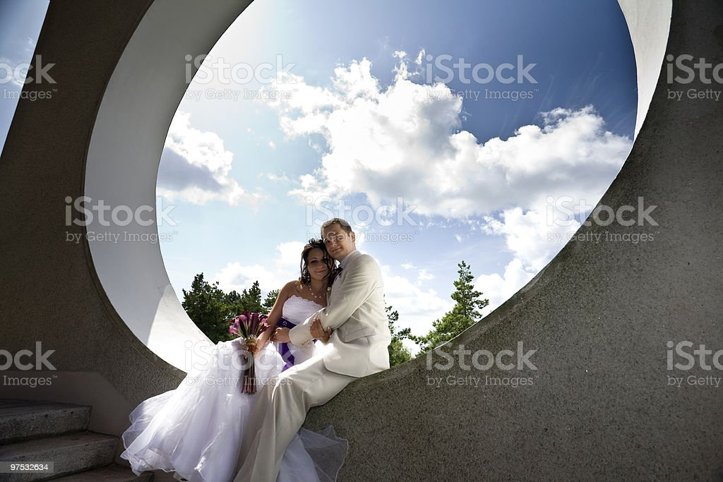 Groom and bride in modern architectural background royalty-free stock photo