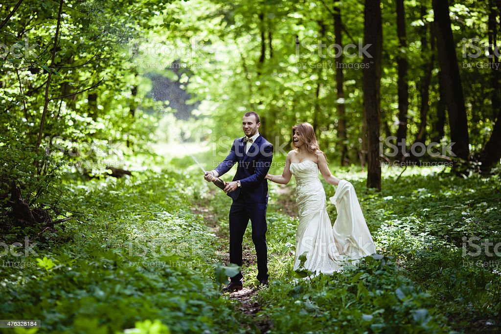 Groom and bride in the spring forest wedding in May, against the background of blossoming nature 2015 Stock Photo