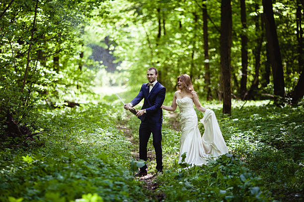Groom and bride in the spring forest stock photo