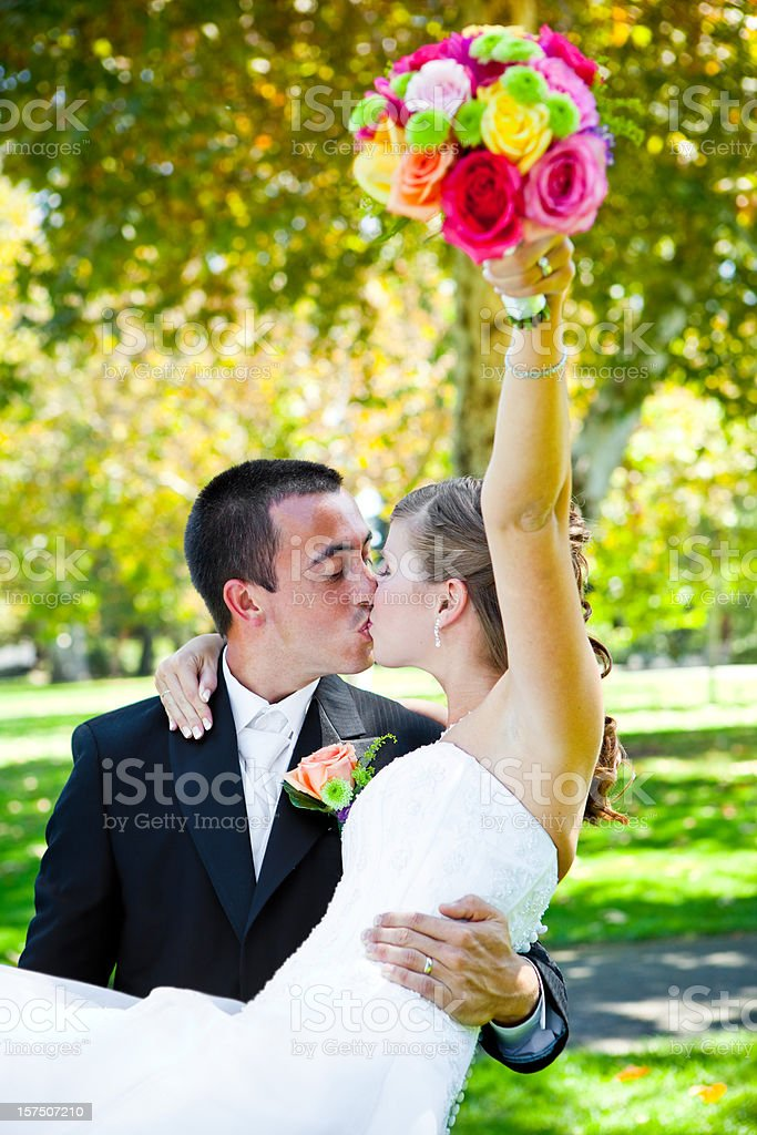groom and bride kiss with air bouquet royalty-free stock photo