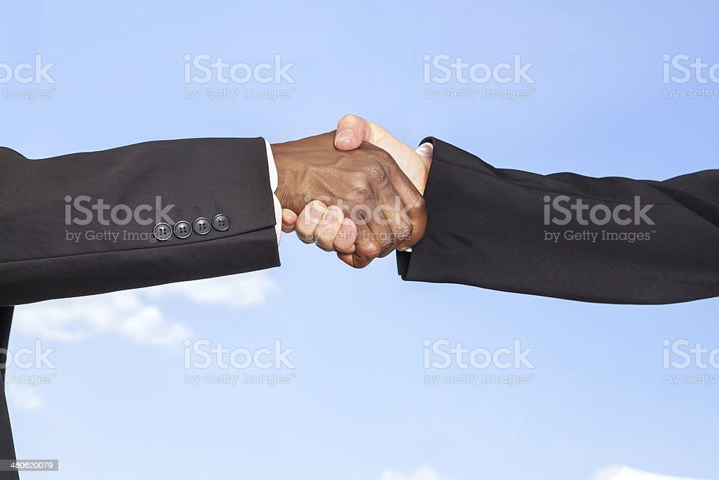 Groom and his best man shake hands royalty-free stock photo