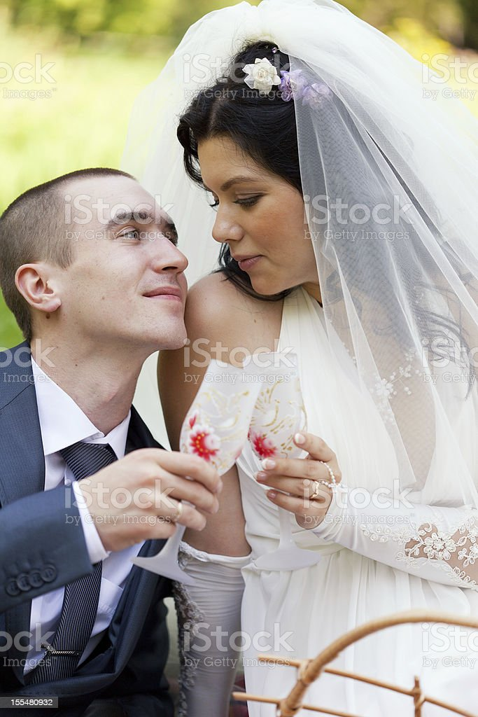 groom and the bride together sit on a grass royalty-free stock photo