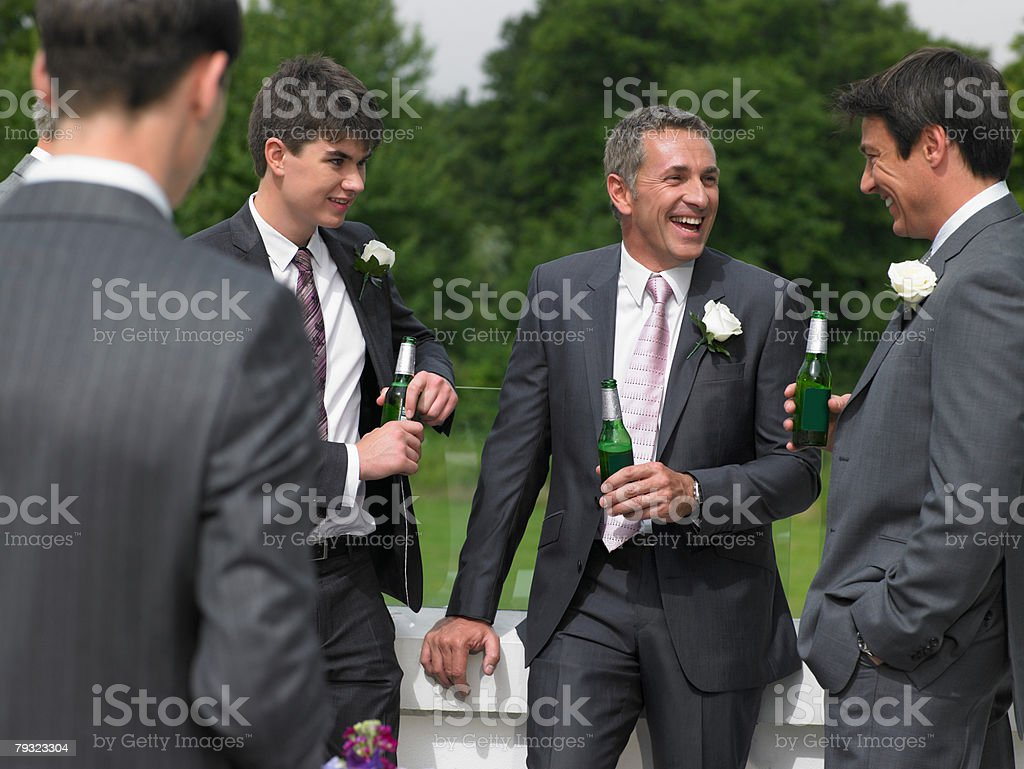 Groom best man and ushers talking 免版稅 stock photo