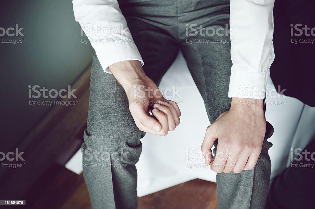 Groom / Best man clutches wedding ring stock photo