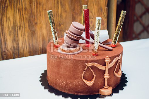 istock groom cake topper couple with legal gavel 914111438