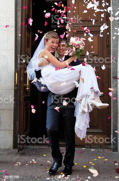 Groom carrying bride out of a doorway picture id153752159?b=1&k=6&m=153752159&s=612x612&h=mt qo0ac2dzsbe7kg3qugzt3zl4fkwu3sgv4a rqpou=