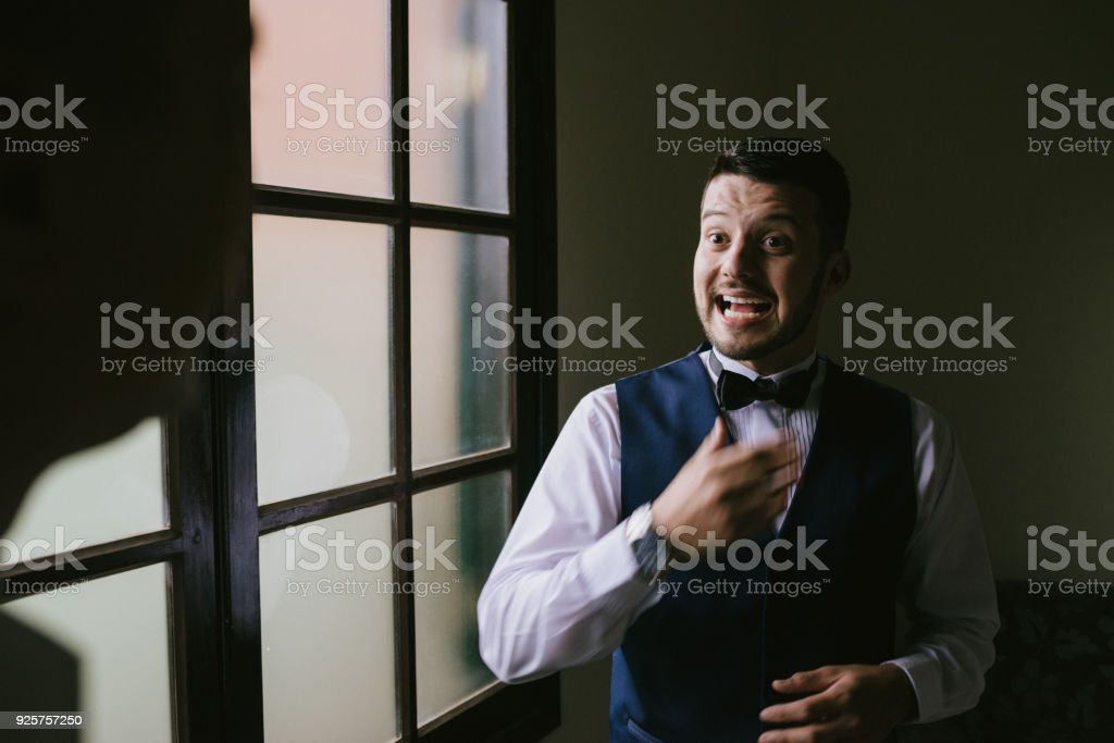 Groom getting ready for the wedding stock photo