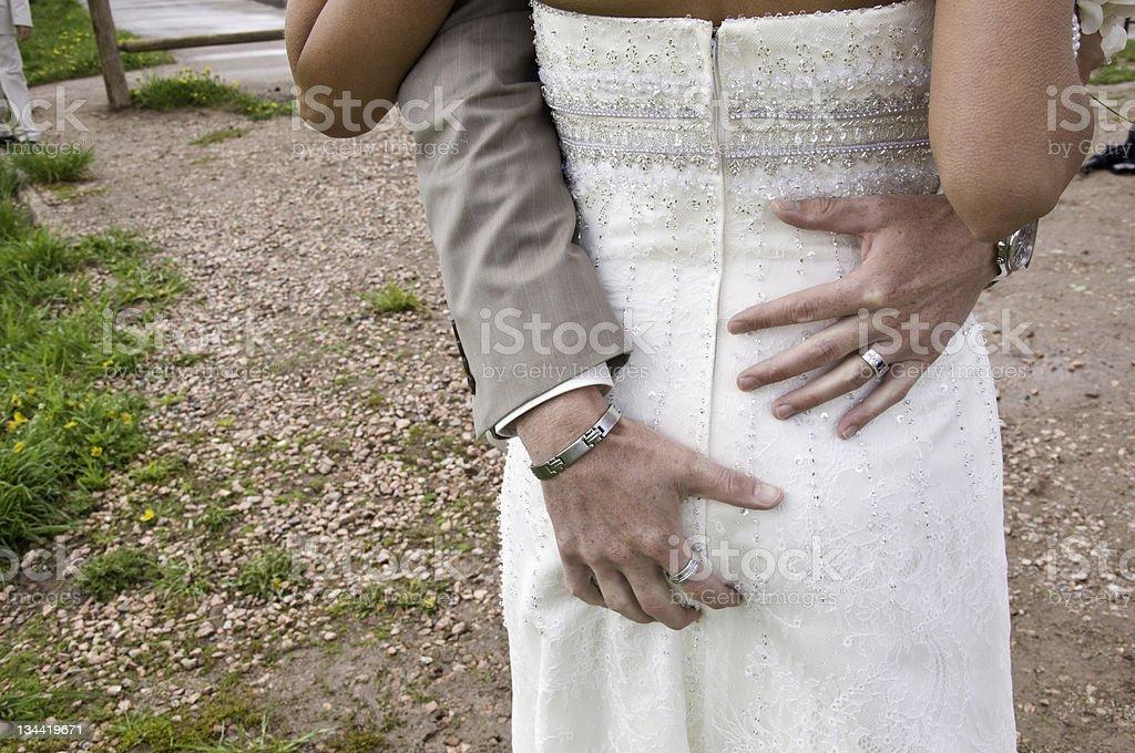 Groom Grabbing Bride's Butt at Wedding stock photo