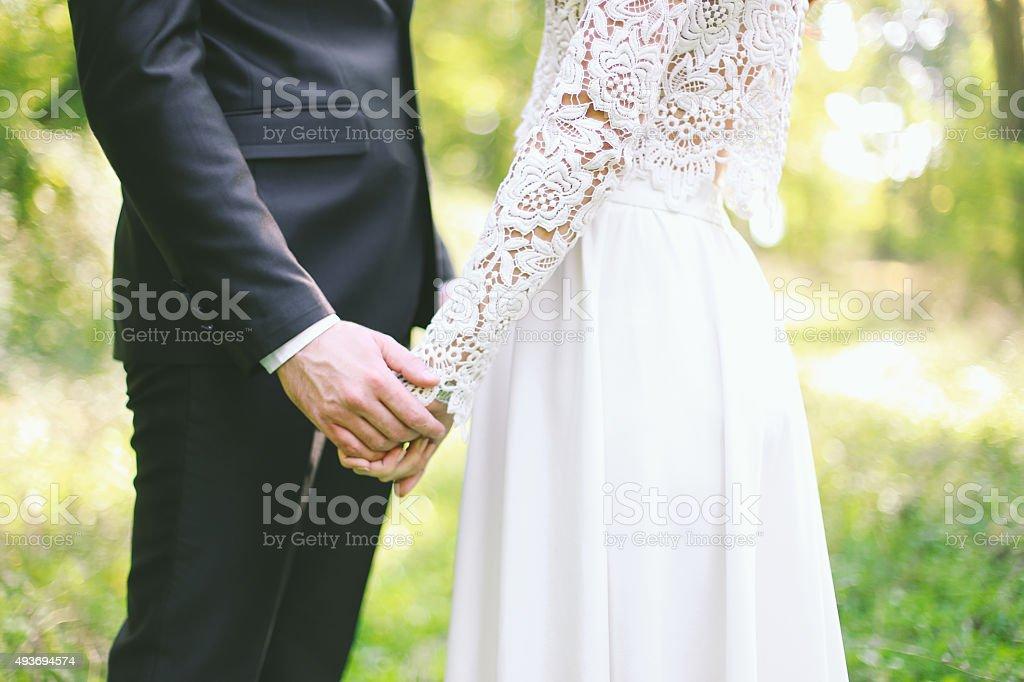 Groom holding bride stock photo