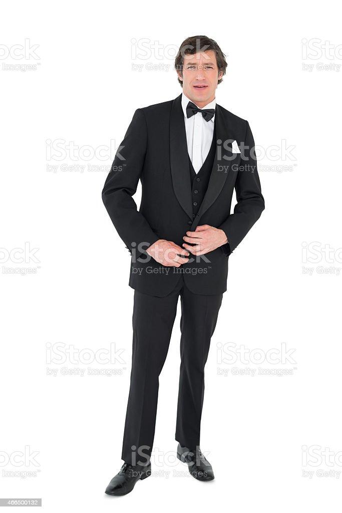 Groom in tuxedo getting ready stock photo
