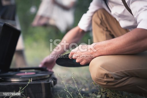 istock Groom Includes A Vinyl Record On Old Vintage Turntable For Their Romantic Date 1022793456