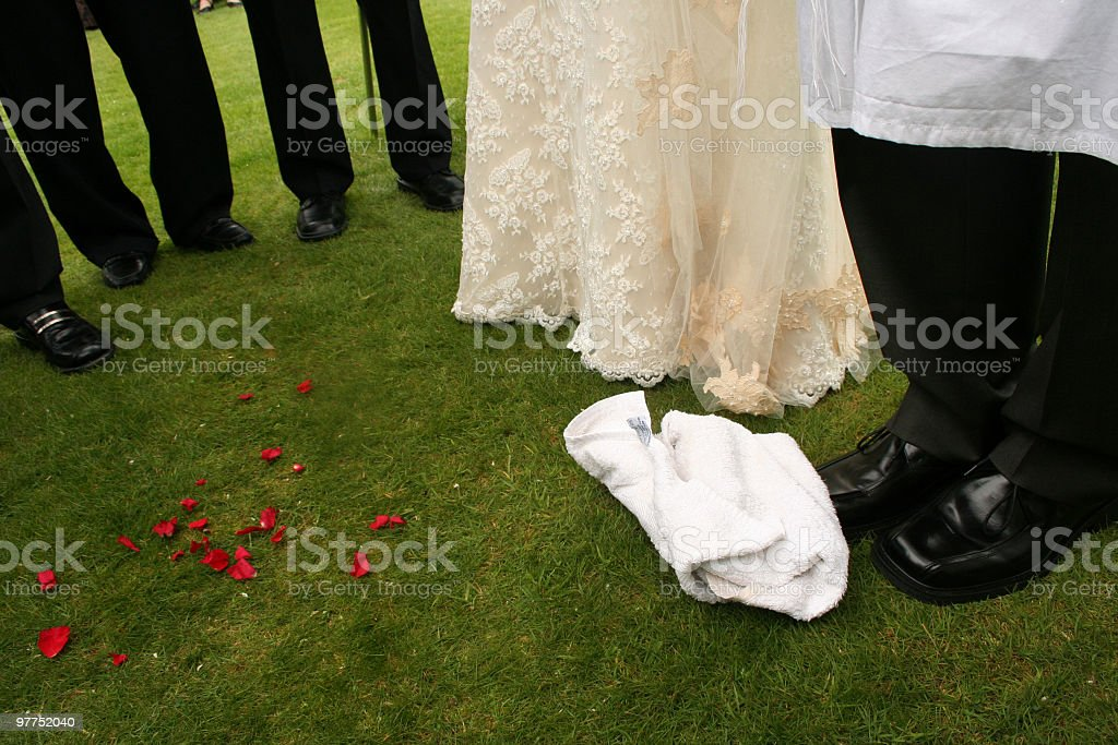 Groom is about to break the glass in wedding, UK stock photo