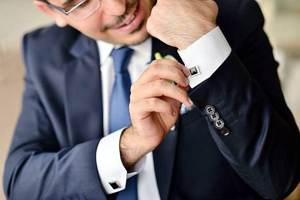 groom is wearing cuff-links indoors - boy handcuffs stock pictures, royalty-free photos & images