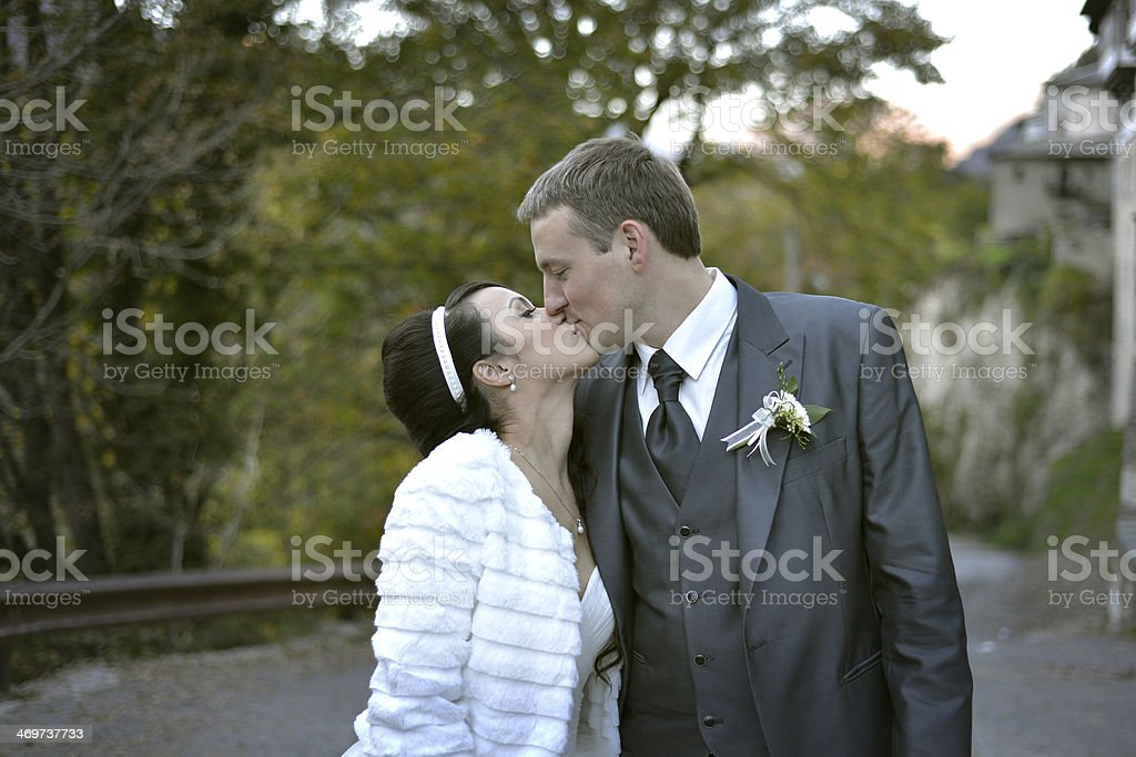 Groom kissing the bride on her forhead stock photo