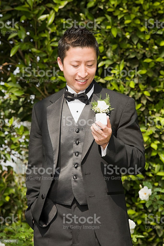 Groom looking at ring 免版稅 stock photo