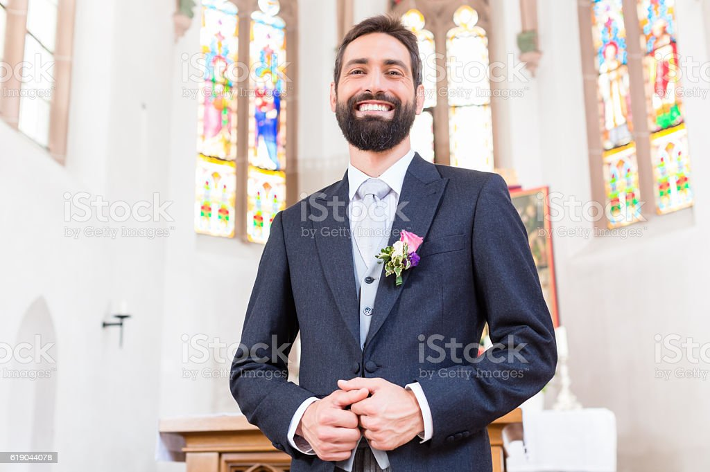 Groom on wedding waiting for bride at altar stock photo