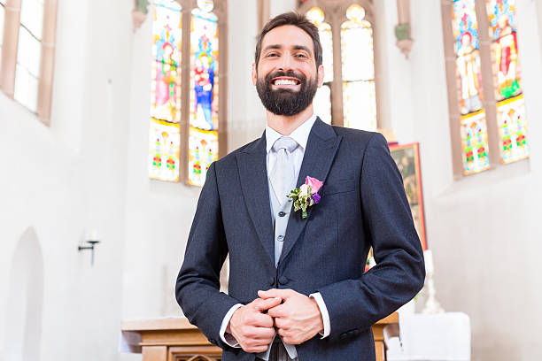 groom on wedding waiting for bride at altar - altar stock-fotos und bilder