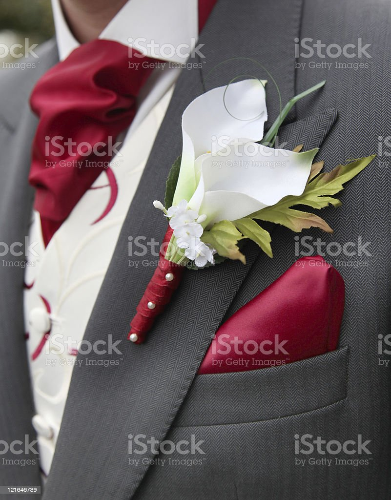 Groom or Best Man Silk Lily Button Hole Flower stock photo