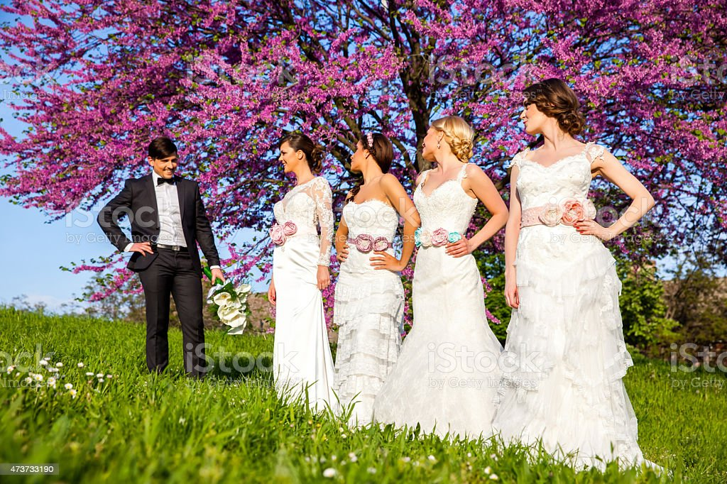 Groom picking a bride stock photo