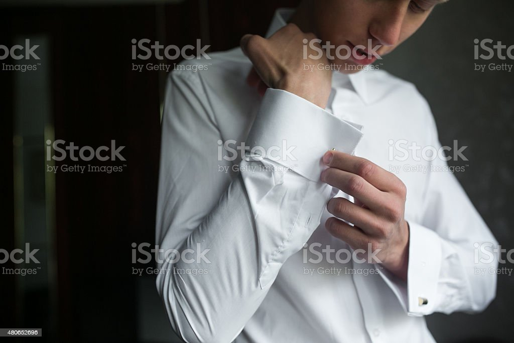 Groom prepares for wedding stock photo