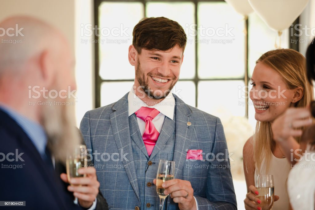 Groom Socialising With His Wedding Guests stock photo