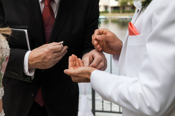 Groom Taking Ring From Pastor On Ceremony On Wedding Day stock photo