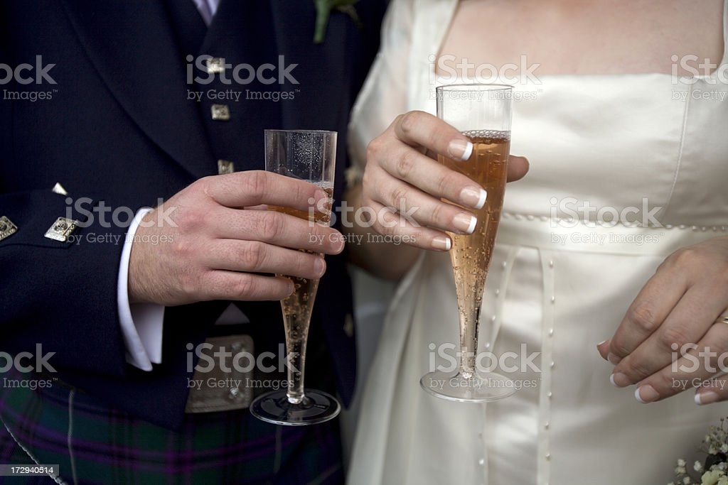 Groom, Wearing Kilt, and Bride Share Champagne royalty-free stock photo