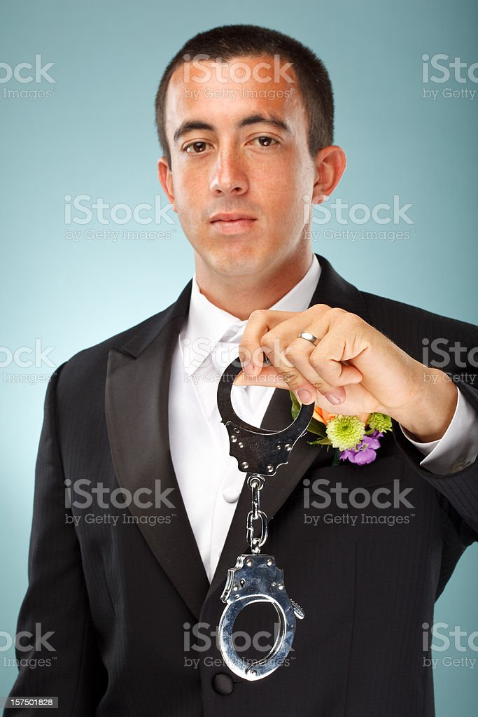 groom with handcuffs royalty-free stock photo