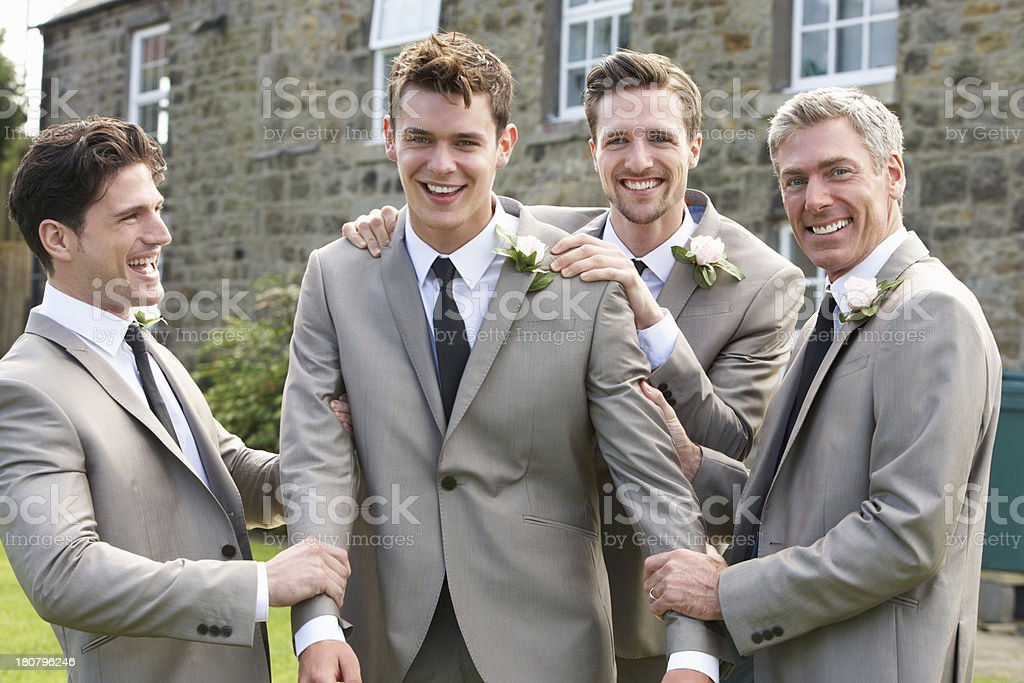 Groom with his best man and other groomsmen at wedding stock photo